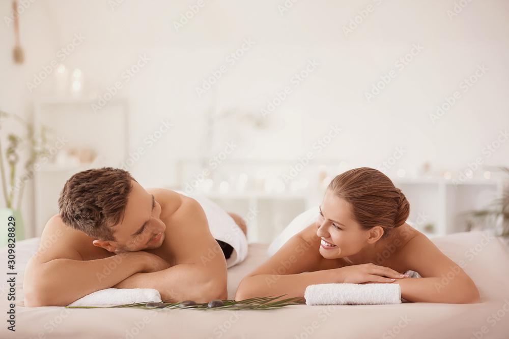 Fototapeta Young couple relaxing in spa salon