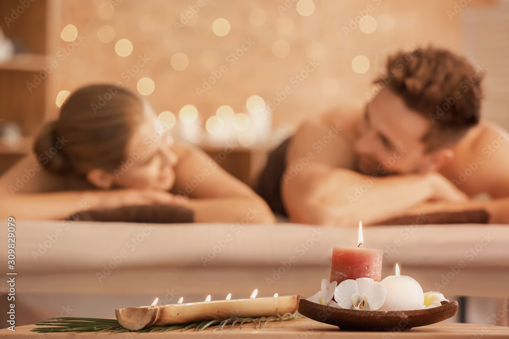 Fototapeta Young couple relaxing in spa salon