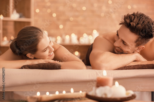 obraz lub plakat Young couple relaxing in spa salon
