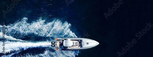 Fotografía Aerial drone ultra wide top down photo of luxury rigid inflatable speed boat cru