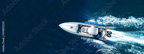 Fototapeta Aerial drone ultra wide top down photo of luxury rigid inflatable speed boat cruising in high speed in Aegean deep blue sea, Greece obraz na płótnie