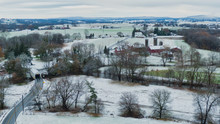 Pennsylvania Aerial Landscape In First Snow, Traditional Farm And Covered Bridge, Keller's Mill In Lancaster County, PA