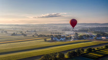 Hot Air Balloons Rise Into The Air Above American Countryside In Pennsylvania