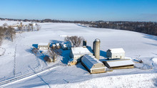 Aerial View Of Farm In Winter, Snow Covered Landscape, Lancaster County, Pennsylvania