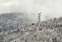 Power Line In Winter, Big, High Voltage Pylon On Minimalist, Snowy Mountain Landscape