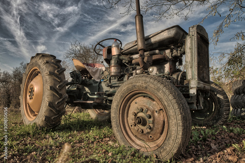 Fototapety, obrazy: Old rusty tractor in a field on a sunny day