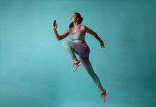 Athletic Young Woman Running O...