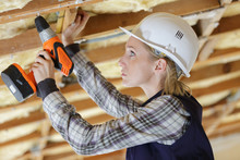 Serious Female Builder With Drill Tool