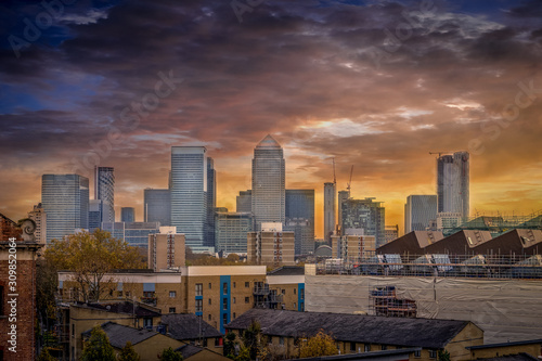 Fototapety, obrazy: View of the London bank district on Canary Wharf with docks and dramatic sunset sky