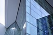 Abstract image of looking up at modern glass and concrete building. Architectural exterior detail of office building.