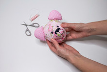 Teddy Bear Head Sewing Process. The Process Of Hand Sewing With Fabric, Scissors, Accessories For Sewing. Hands Sew A Toy