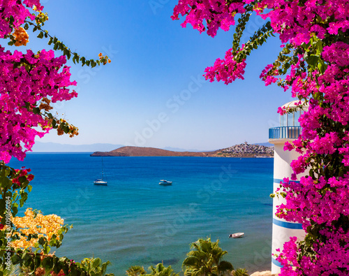 Stampa su Tela Beautiful pink and purple flowers frame a sea view in Ortakent, Bodrum, Turkey