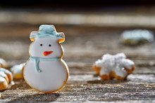 Iced, Santa And Snowflake Decorated Christmas Cookies On Rustic Wood Surface With Dramatic Lighting