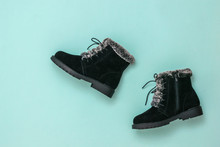 Black Women Boots For Winter On Blue Background. Flat Lay.