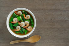 Hot And Sour Okra Soup With Shrimp In A Bowl On Wooden Table, Top View. Asian Homemade Style Food Concept.