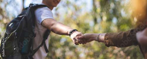 Obraz Asian Young Couple holding hands over nature background. - fototapety do salonu