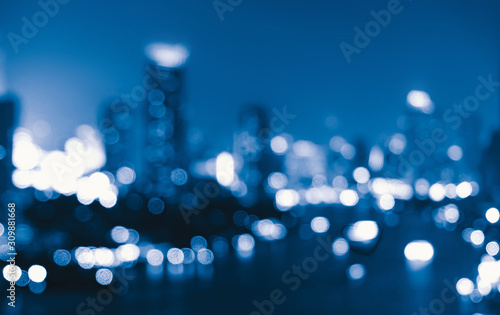 mata magnetyczna Bokeh background of skyscraper buildings in downtown. Urban city with lights, Blurry photo at night time. illuminated Cityscape