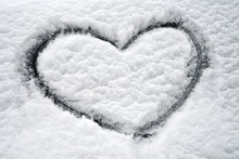 Close Up On Drawing Hearts On Car Windshield After Snow