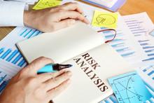 Businessman Reads Risk Analysi...