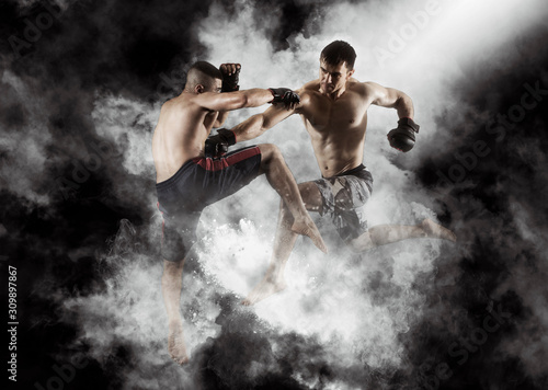 Photo MMA boxers fighters fight in fights without rules