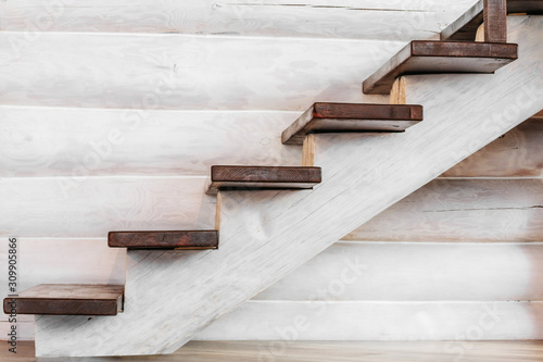 a wooden staircase with a wooden log in the house