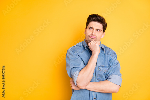 Obraz Photo of bewildered funny cute evil man pondering over his future plans looking into empty space isolated vivid color background - fototapety do salonu
