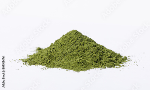Obraz na plátně Heap of matcha green tea powder isolated on white background, Organic product fr
