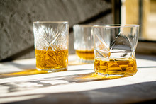 Whiskey In Glasses On Table In...