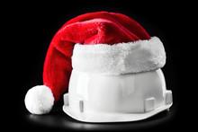 Santa Claus Helper Hat On White Building Helmet. Isolated On Black Background
