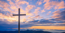 Cross On A Mountain Top With Beautiful Sunset Sky