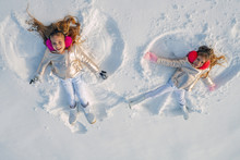 Two Girls On A Snow Angel Show...