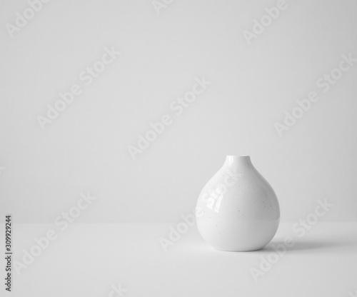 Fototapeta white vase on table obraz