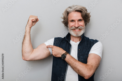 Fotomural Portrait of a handsome stylish mature man wearing a vest