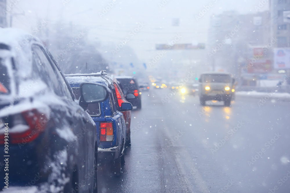 Fototapeta cars on winter road traffic jam city / winter weather on the city highway, the view from car in the fog and snow road