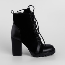 Black Womens Leather Ankle Boots Demi Season With Lacing And High Thick Heels. Studio Photo For The Catalog