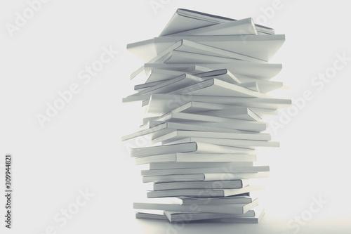 Foto 積み重ねた白い本とノートパソコン