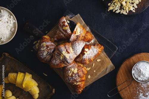 Fototapeta breakfast croissant with chocolate on a dark stone background top view