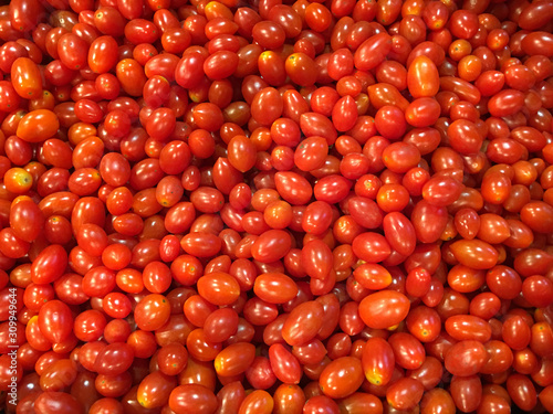 Fresh red cherry tomatoes in supermarket.Fresh cherry tomatoes background texture.