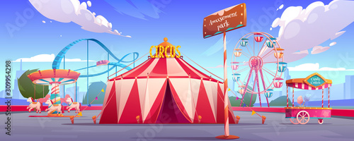 Foto Amusement carnival park with circus tent, ferris wheel, roller coaster, merry-go