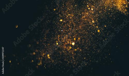 glitter vintage lights background. gold and black. de focused Canvas Print