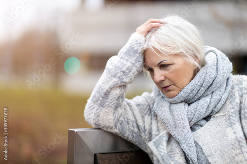 Portrait of senior woman looking depressed Canvas Print