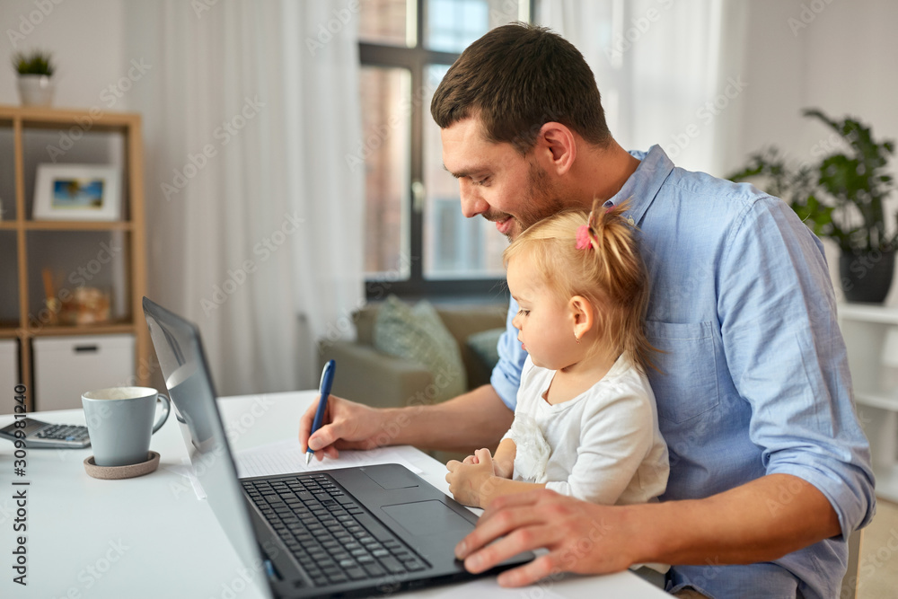 Fototapeta multi-tasking, freelance and fatherhood concept - working father with baby daughter and laptop computer at home office