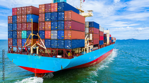 Fotografía Aerial view container ship carrying container in import export business logistic and transportation of international by container ship in the open sea