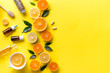 canvas print picture - Composition with tropical fruits. Orange, lemon, lime, grapefruit on a yellow background. Flat lay top view copy space. Nutrition Concept, Vitamin C, Disease Prevention, Flu