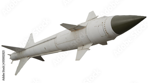 Photo A missile with a warhead on a white background isolated