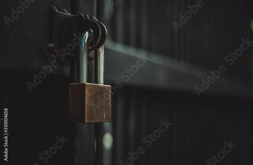 Fototapeta Closeup steel door with lock , padlock , key lock , dark background obraz