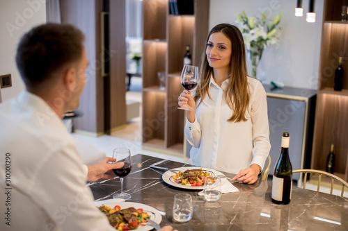 Sweet couple having a romantic dinner at luxury kitchen Canvas Print