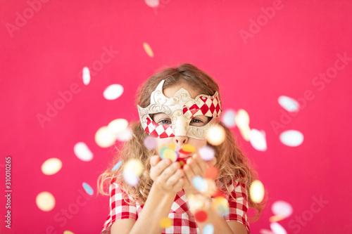 Obraz Fancy girl blowing confetti against pink bakground - fototapety do salonu