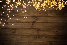 Golden Lights On Wooden Background