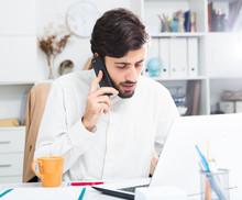 Office Worker Talking On Mobil...